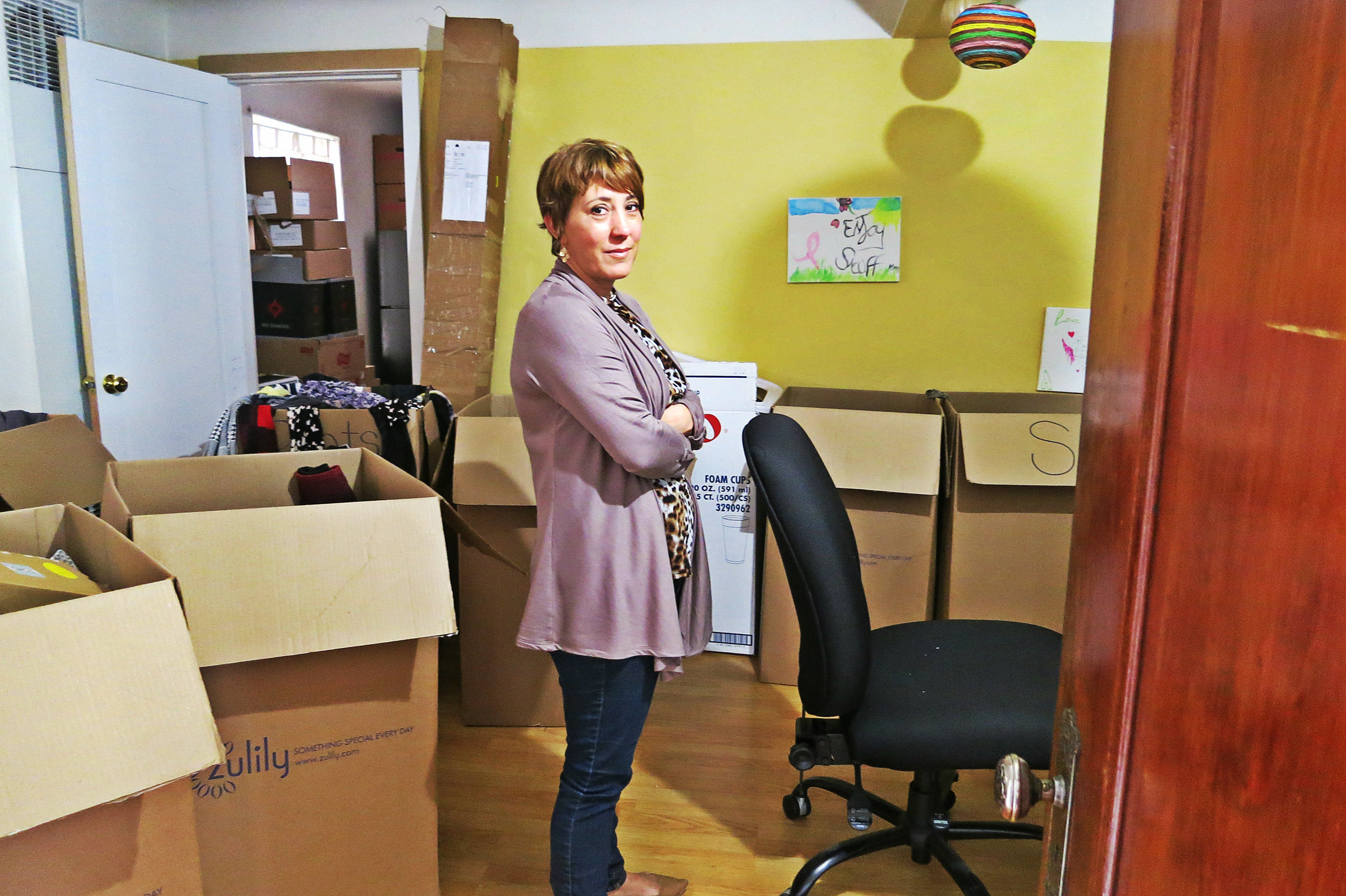 """Michele stands in a room devoted to donated items.""""We're letting them come in here two at a time to take what they need."""""""