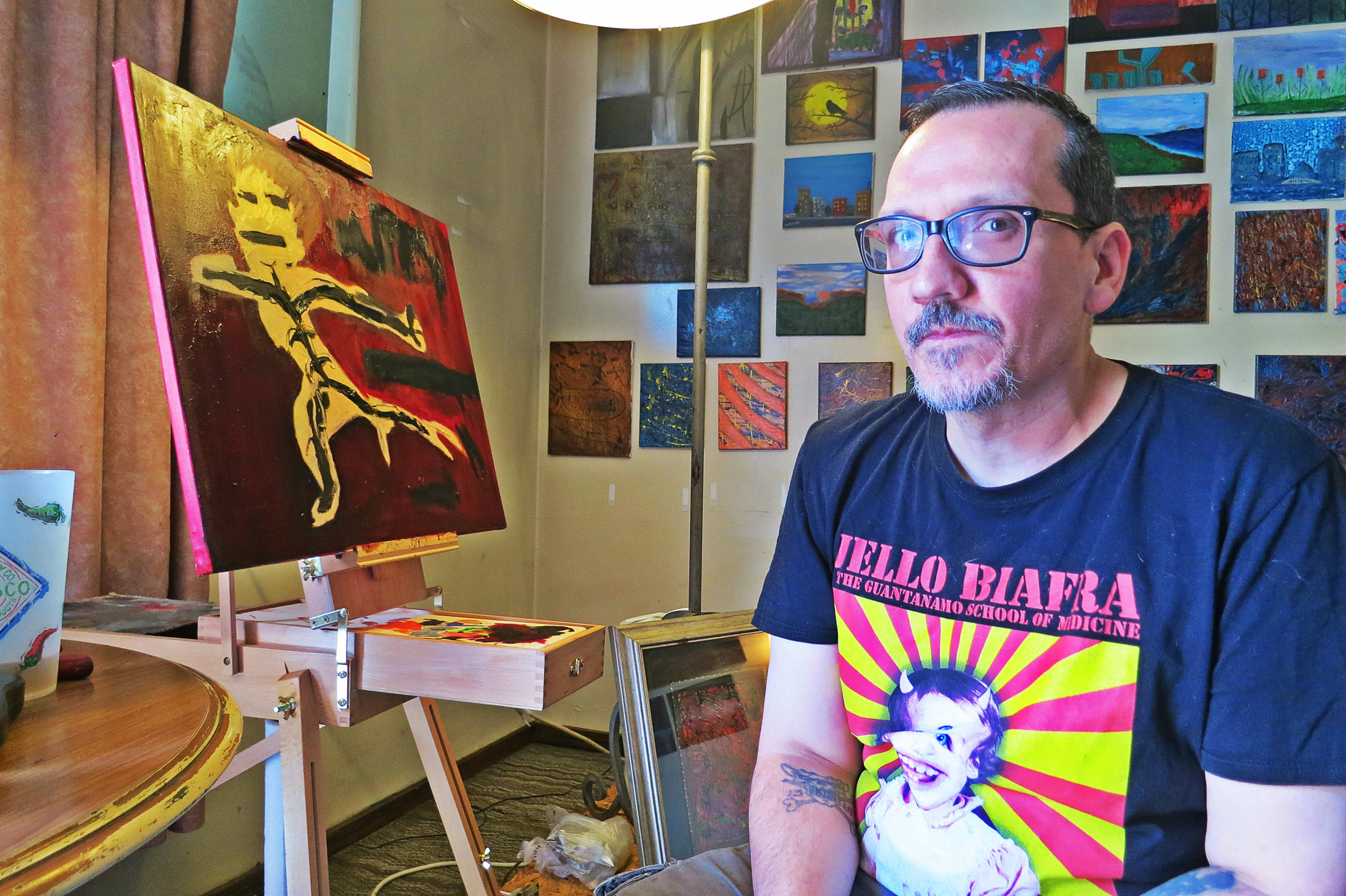 """Chad poses in front of a work in progress painting possibly called """"My Shadow"""". """"My paintings just come out and end up looking like they do,"""" he said during a recent visit. This photo was taken during Nada Dada 2016."""