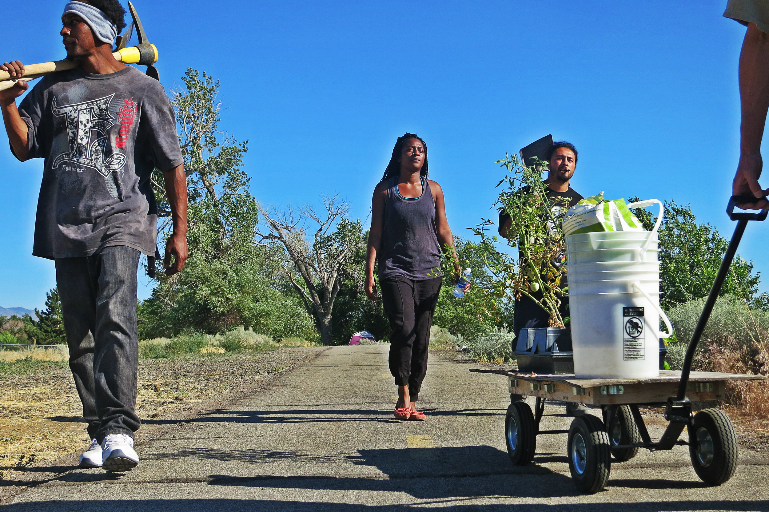 Niesha Jones (center) goes up and down the path along the Truckee River with other activists to help the homeless living there.