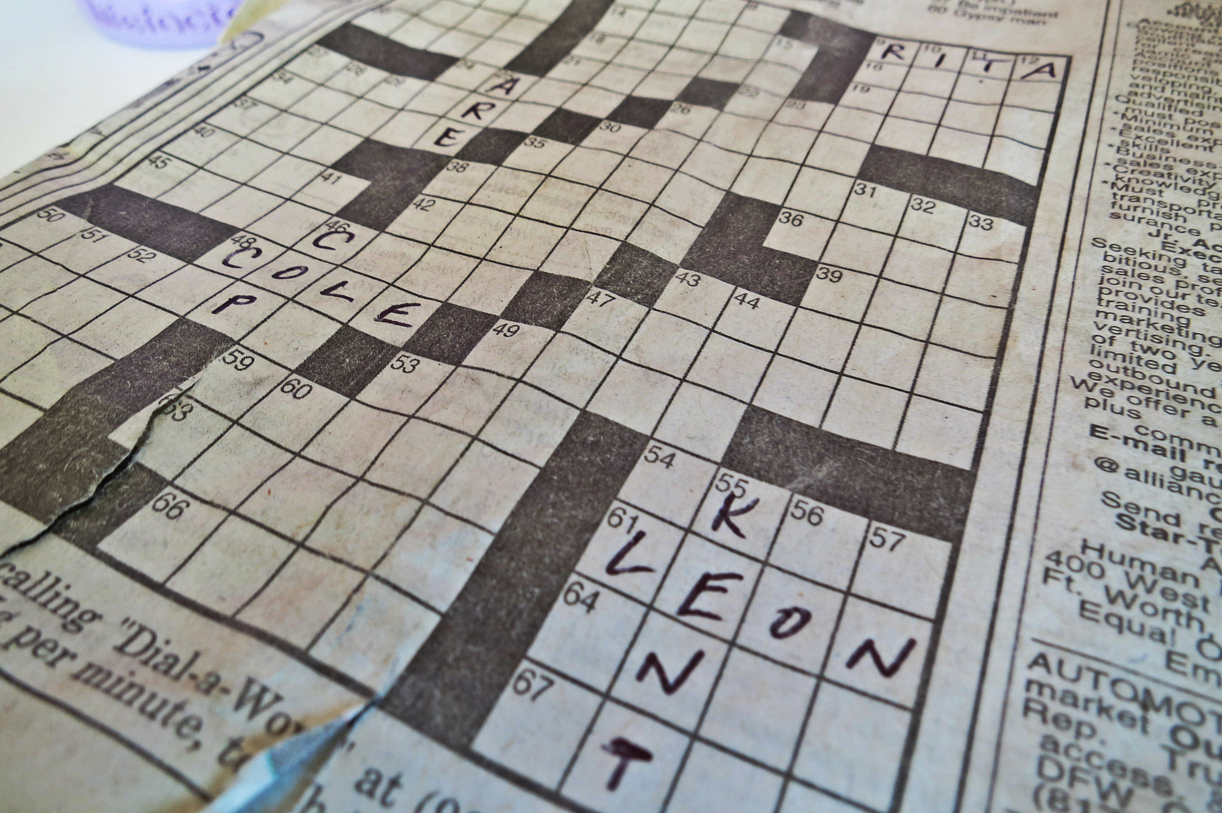 The unfinished crossword puzzle with the neat handwriting went back in her Dad's old bags, as we finished the interview.