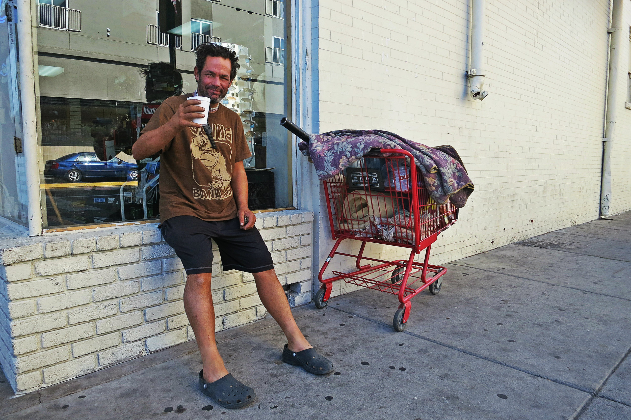 """""""I'm just holding on to my life,"""" Christian says of recently being robbed of many of his possessions after getting some money from a passerby to get some coffee."""