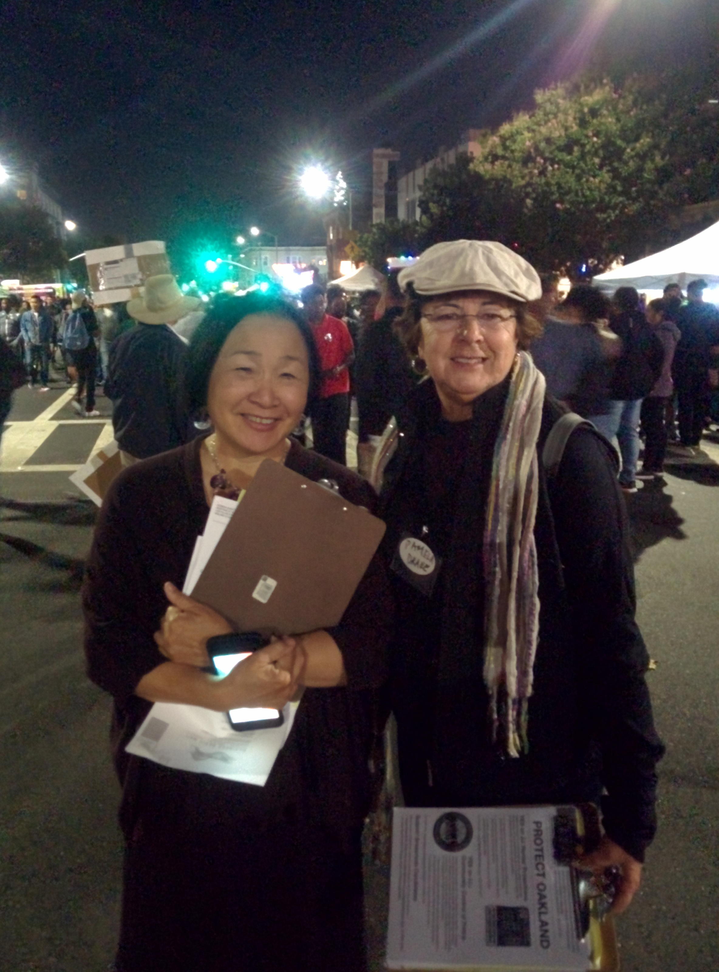 Jean Quan (left) during an Oakland First Fridays Festival, campaigning for a renter protection ordinance, had advice for a city like Reno beginning to experience its own gentrification issues. Photo by  Ruben Kimmelman