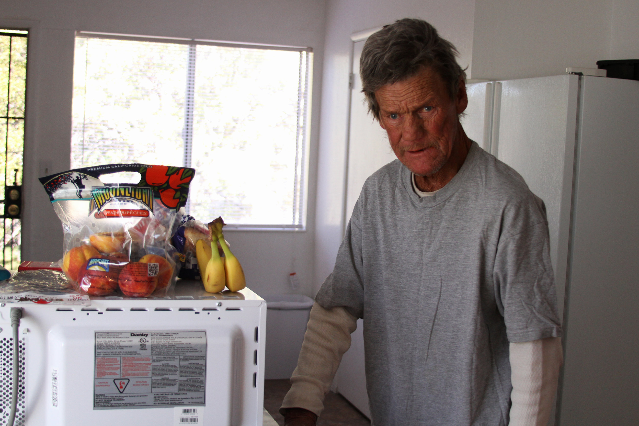 Doug gets to use a shared kitchen with housemates in downtown Reno, after being homeless on a porch.