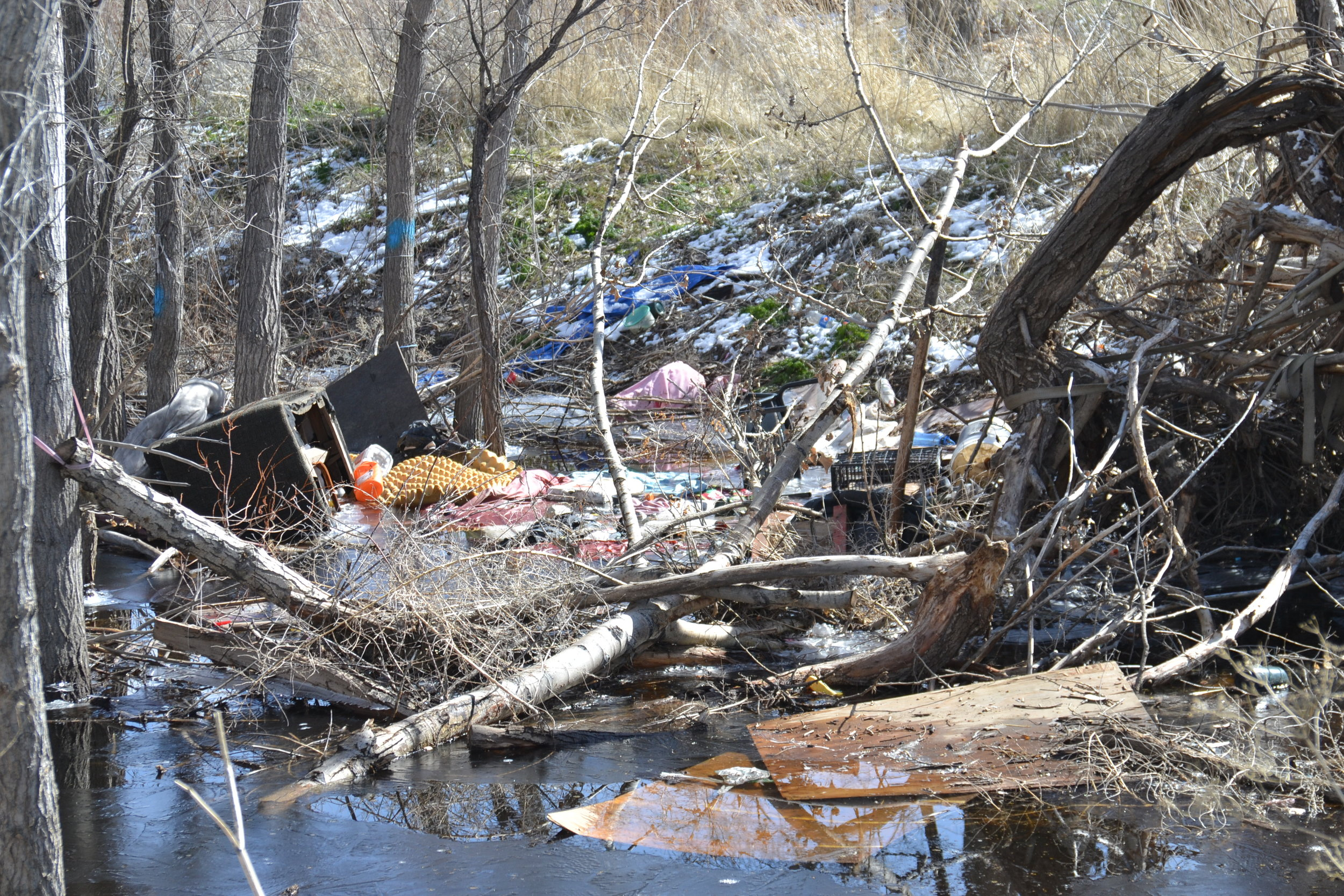 Melting snow, heavy rain, rising waters and new campers who came through have created more trash than usual. This is right by the current sleeping spot for the River Rats. Photo by Jacob Jacoby for Our Town Reno