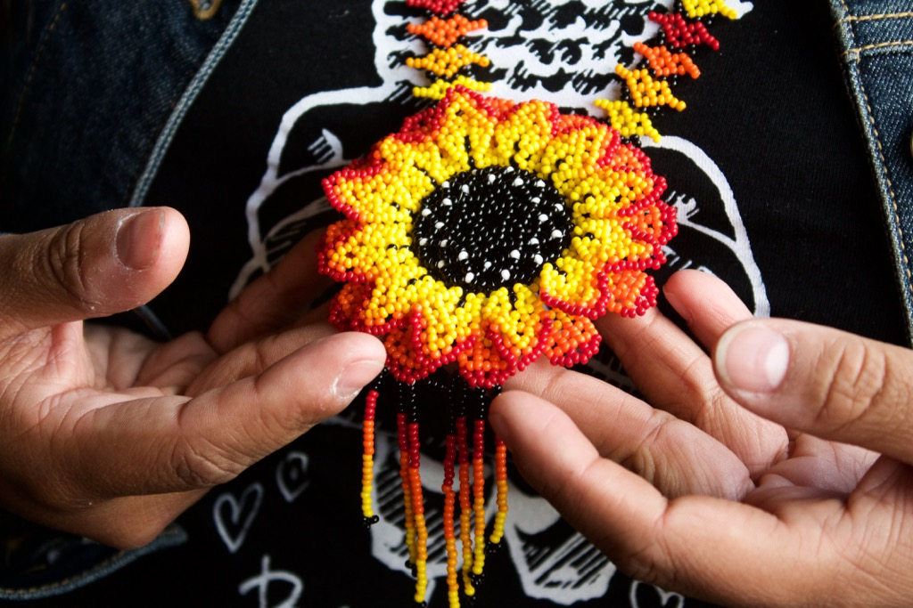 Made by the Huichol people of western Mexico, Ramirez received this necklace from her aunt. She said the red, yellow and orange were her great grandmother's colors, symbolizing the monarch butterfly. Photo by Alexandra Mosher / Our Town Reno