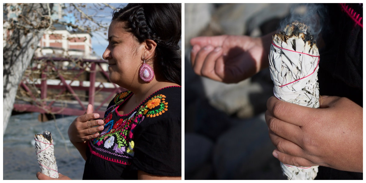 """Ramirez, dressed in her traditional garb, burned sage near the Truckee River in Reno.""""Sage is important because it's a very sacred medicine here in this territory and for me the way I like to honor this territory and the people of this territory is to smudge with sage."""" Photo by Alexandra Mosher / Our Town Reno"""