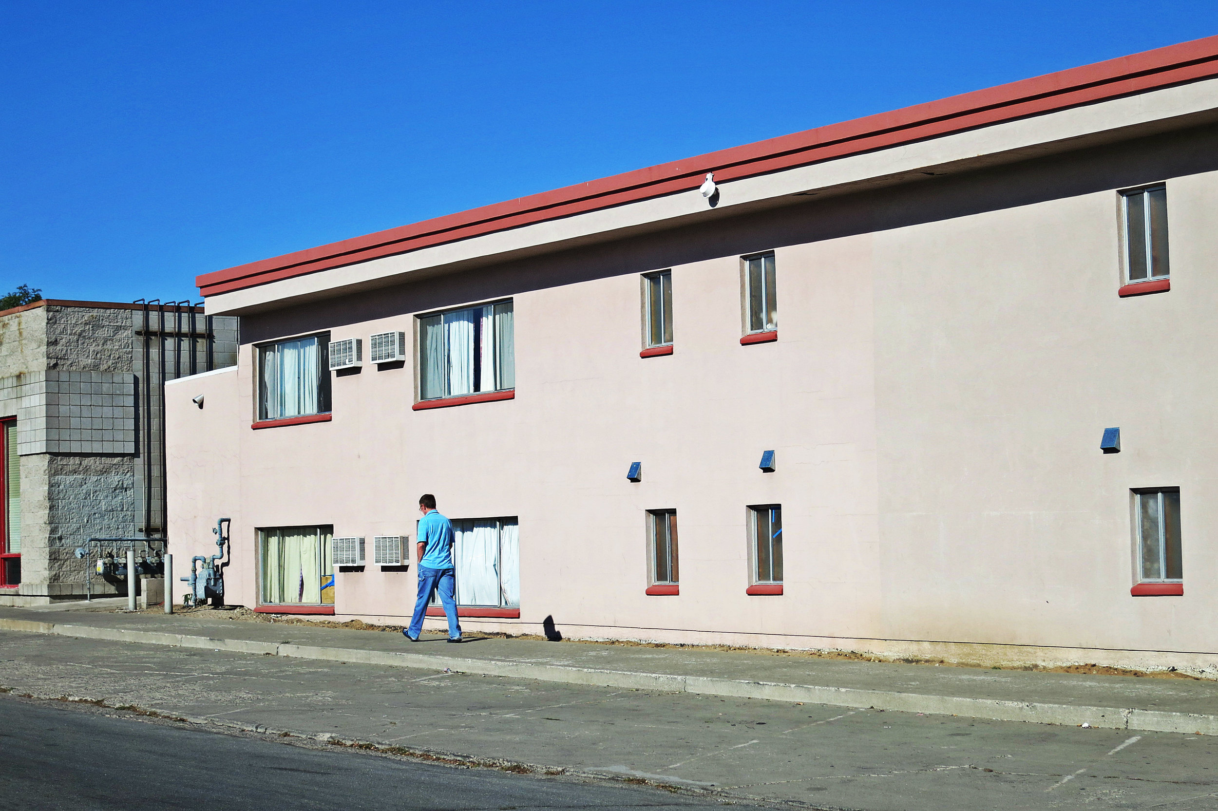 """A backside of the Desert Rose Inn. """"Here we have rather diverse walks of life and we also have people who come through and need a place to stay for a few weeks while they transition to other housing, while they look for a job,"""" McAllister said."""
