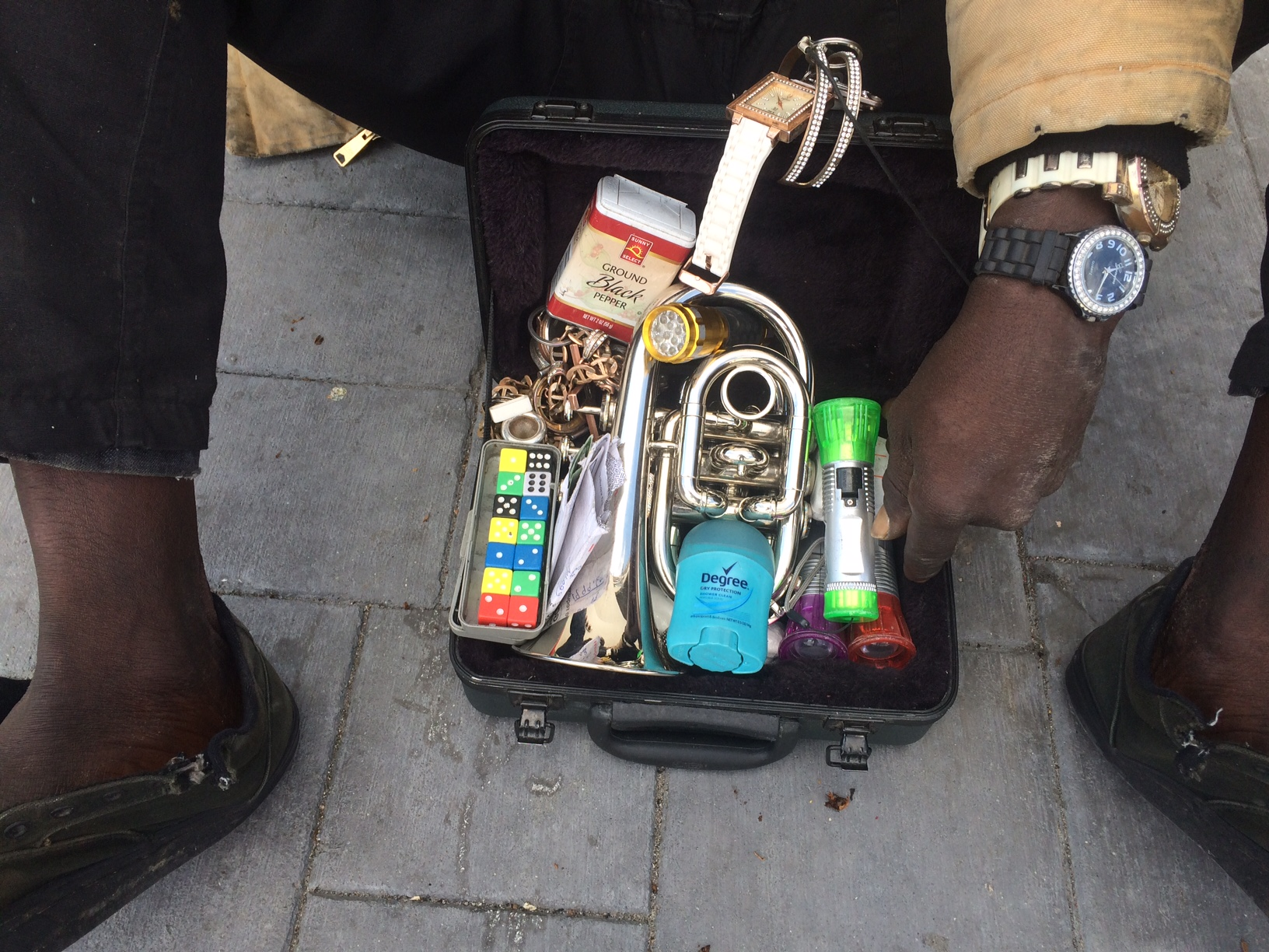 """""""I'm tired, my brain is tired now. Time to stop talking to you. My brain is tired,"""" he said as we asked more questions. Steve carries a mini black attache case with knick knacks such as colorful dice, deodorant, flashlights and jazz instruments. Photo by Prince Nesta for Our Town Reno"""