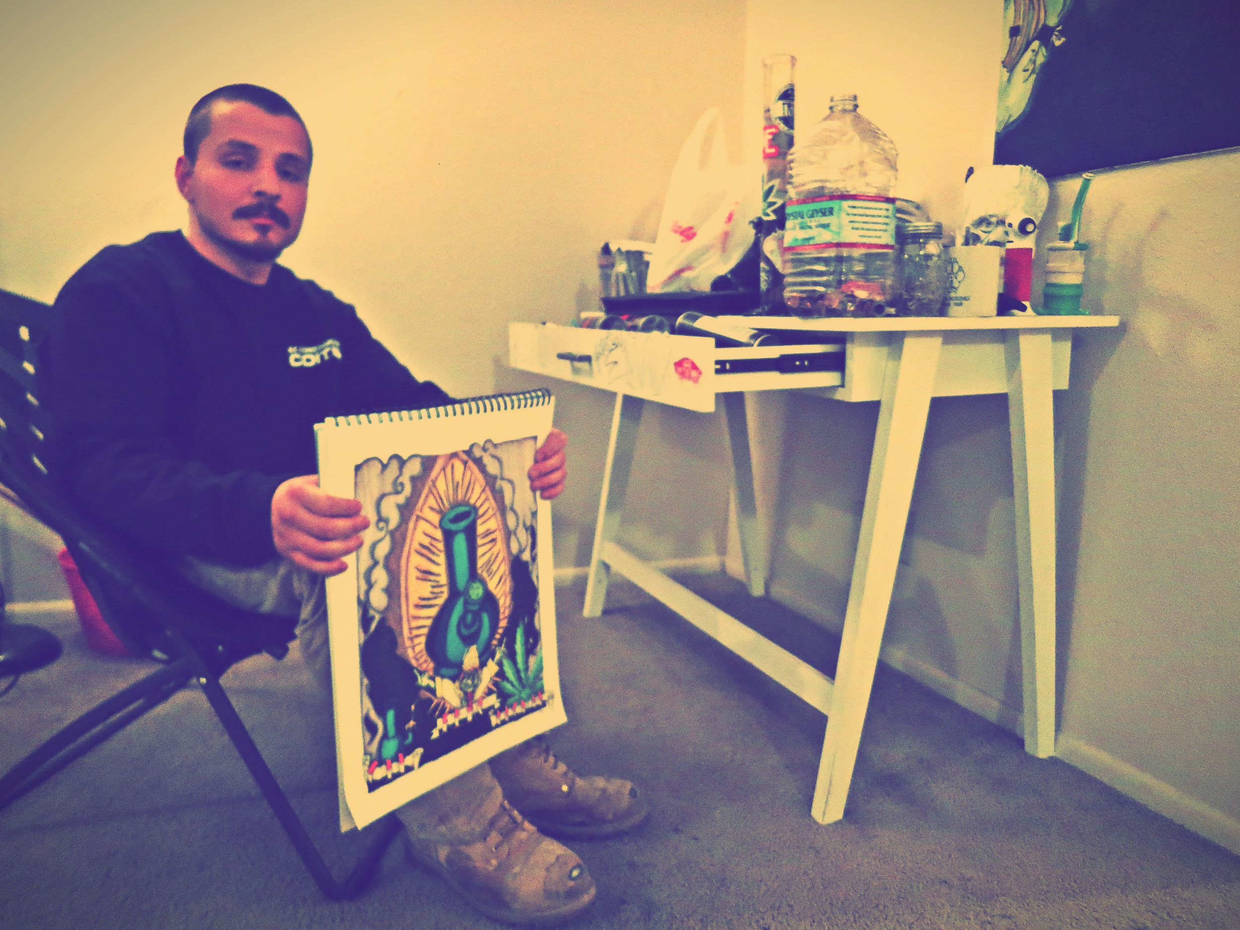 Reno-raised former collegiate boxing champion, Jarred Santos, 24, has a corner of his apartment dedicated to his art.
