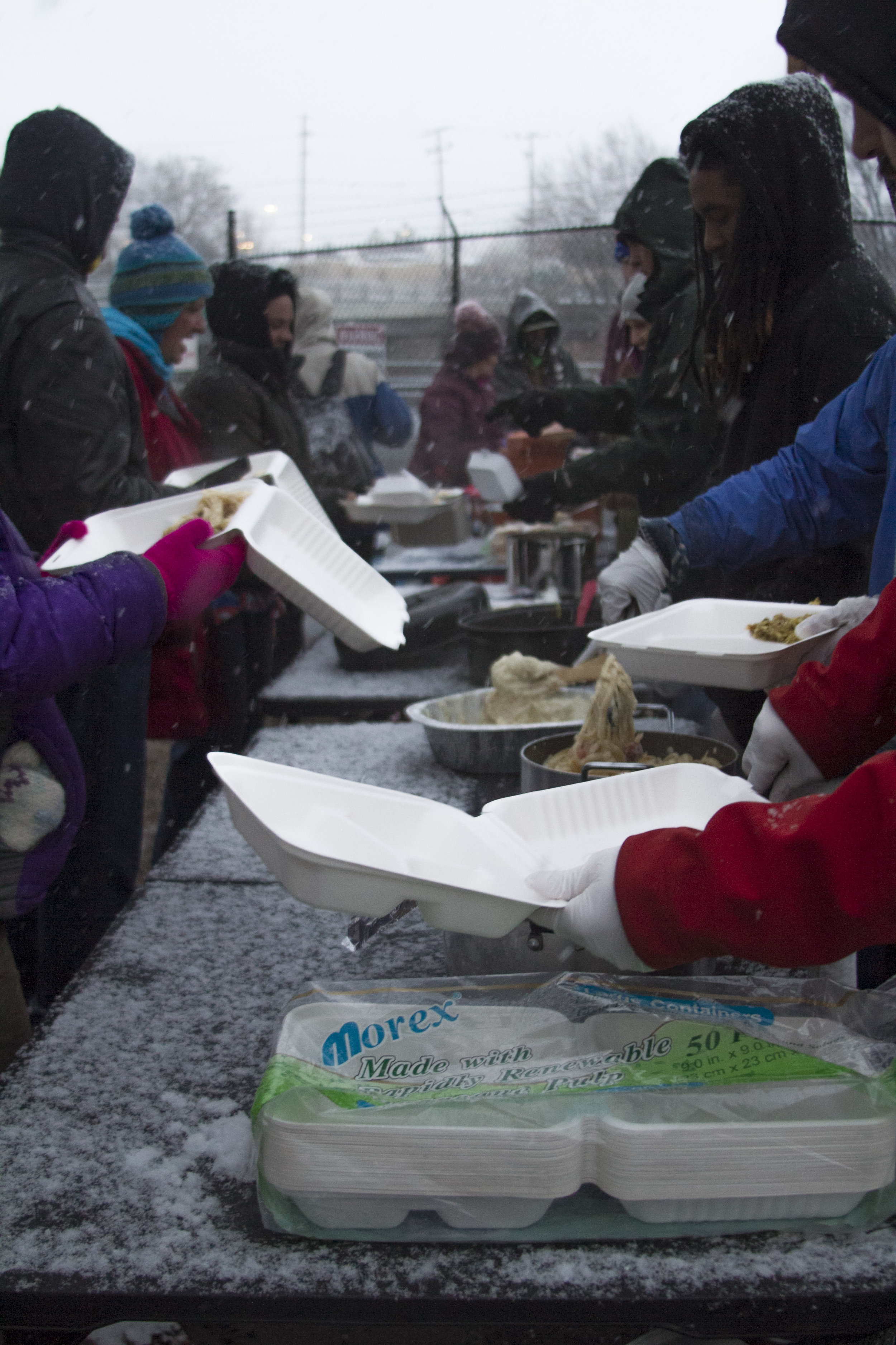 For over an hour people in need wrapped in coats shuffle through the line to fill their stomachs before they retreat beneath a nearby bridge to try and sleep through the cold night. Photo and Reporting by Jordan Gearey for Our Town Reno.