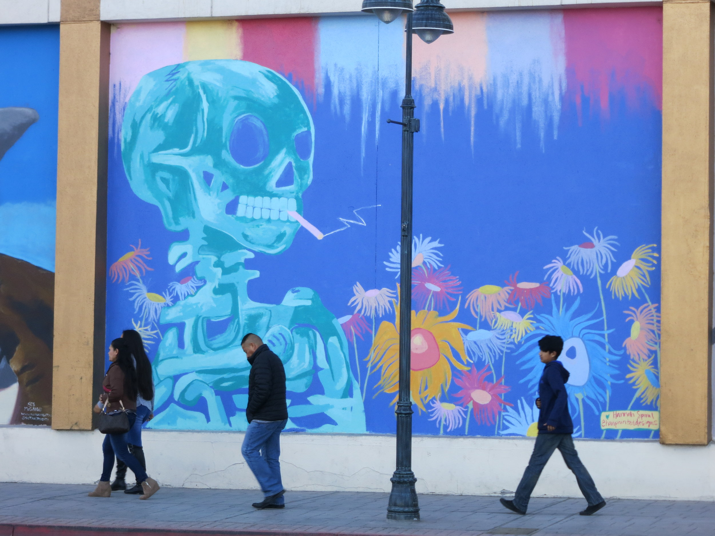 Controlled Street Art: Pedestrians walk by city and competition sanctioned mural art in downtown Reno.