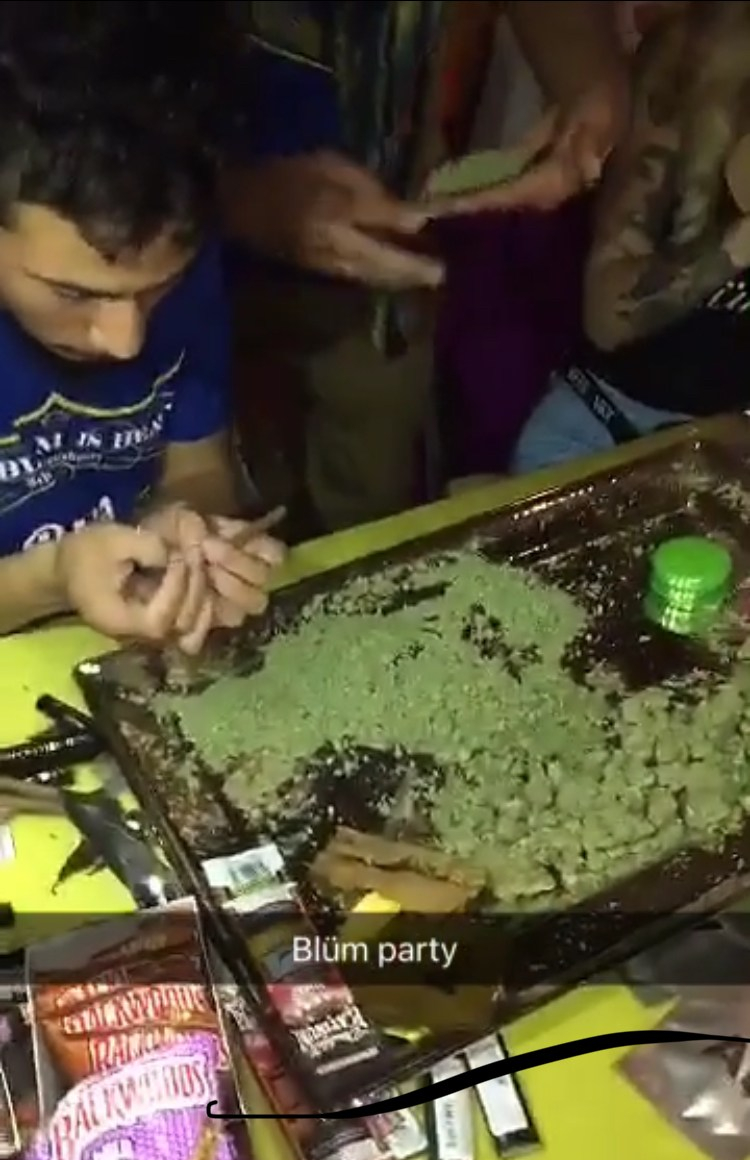 A Snapchat moment from a 2017 Blum party during which employees rolled blunts.