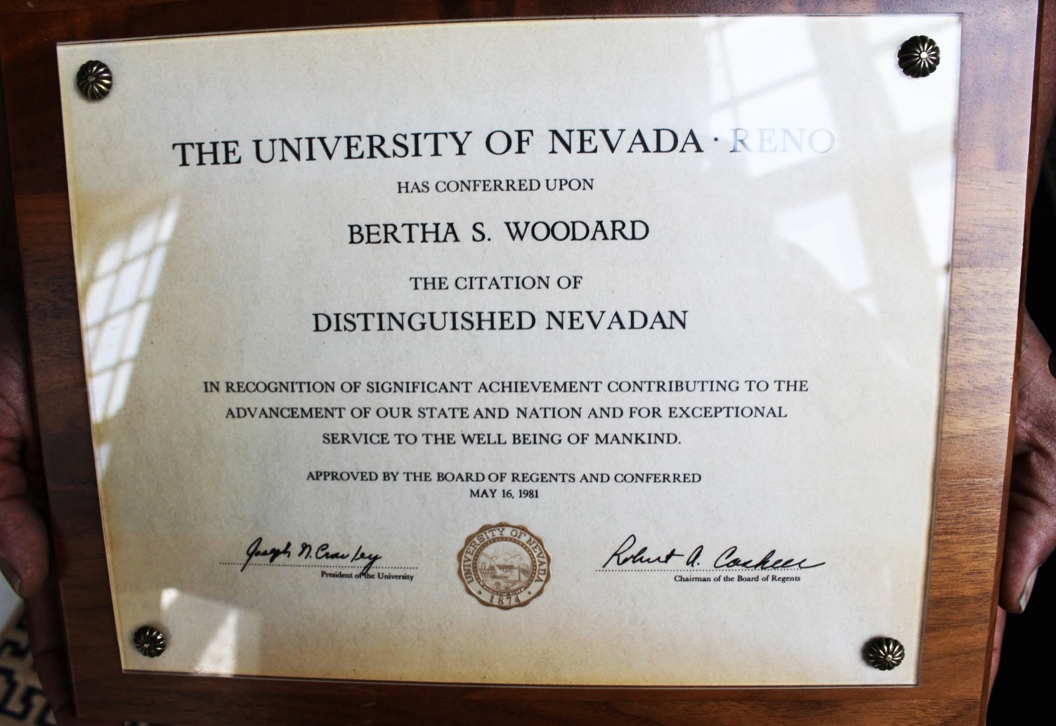 Dalton holds the framed certificate issued in May 16, 1981 by the University of Nevada, Reno and approved by the Board of Regents recognizing civil rights activist Bertha S. Woodard as a distinguished Nevadan. This is just one of her plaques and awards that is in Dalton's possession.