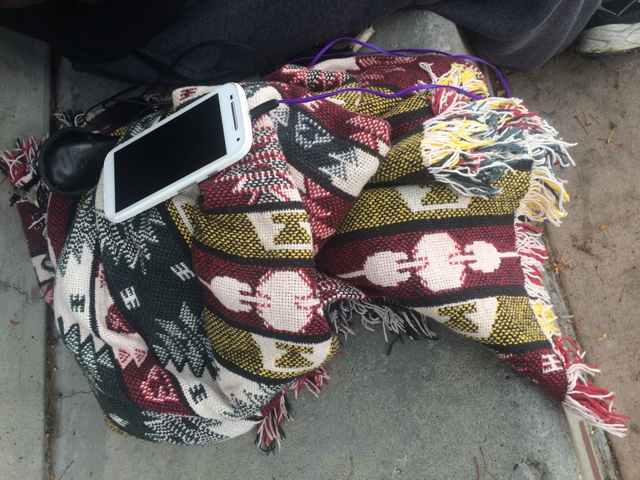 """I just have my phone that doesn't work, a blanket and a jacket,"" he said. Photo by Prince Nesta for Our Town Reno"