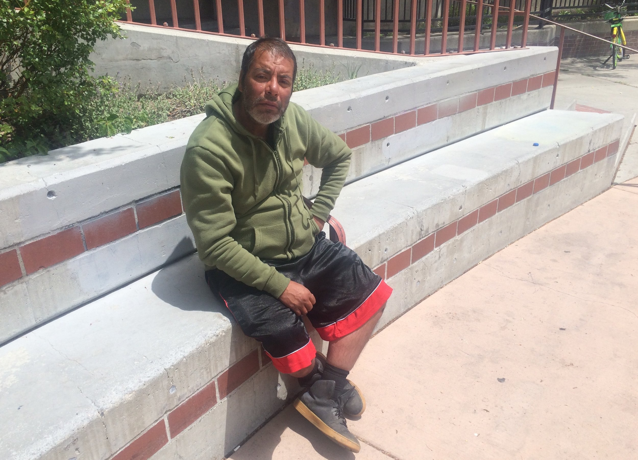 """When we met Manuel, 42, he was spending his day in downtown Reno, watching the river. """"I just mind my own business. I'm just a simple man. I don't have anything to hide, I pay my taxes, I go to church, I go to meetings,I'm trying to get sober. I just come down here to look at the water and see the people."""" Photo and Reporting by Prince Nesta for Our Town Reno."""