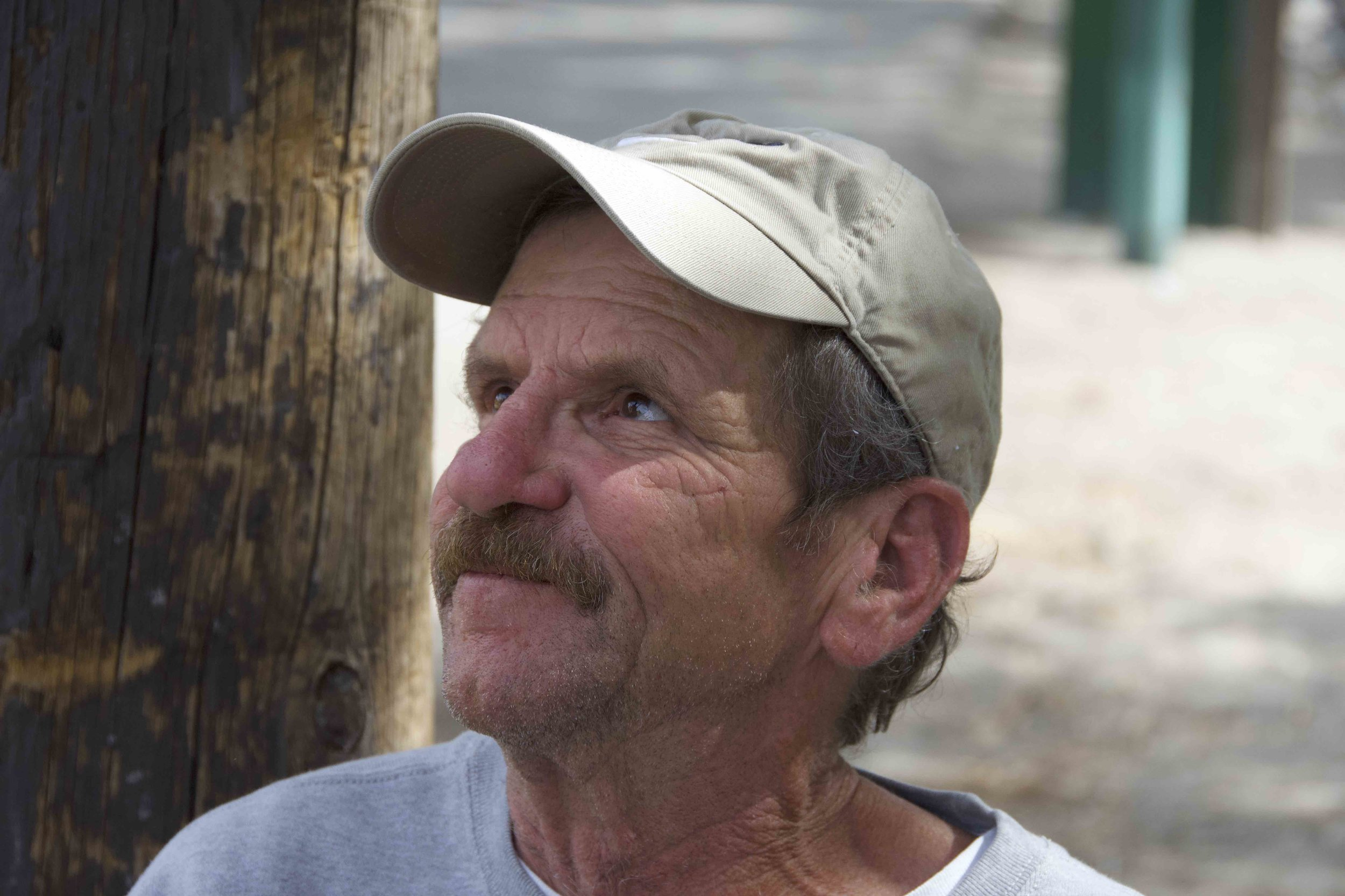 """""""Last year, man, I had this chick cave in my face at a motel. I lost my job. I lost my sight over on the side. I'm a printer, you know, it's taken this long to get myself back together. I've been out here since March … But anyway, things have been looking up,"""" Jimmy Penrod said of why he was living on the streets. Photo by Jordan Blevins with reporting by Prince Nesta."""