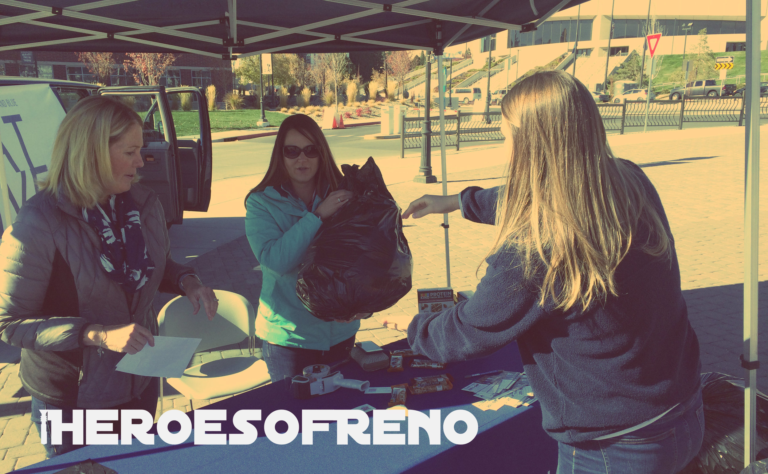 Julie Dunlap (left) and Lauren Sankovich (middle) are members of the Nevada Alumni Association's Women of Silver & Blue helping the Big Reno Coat Drive today on campus at the University of Nevada, Reno.