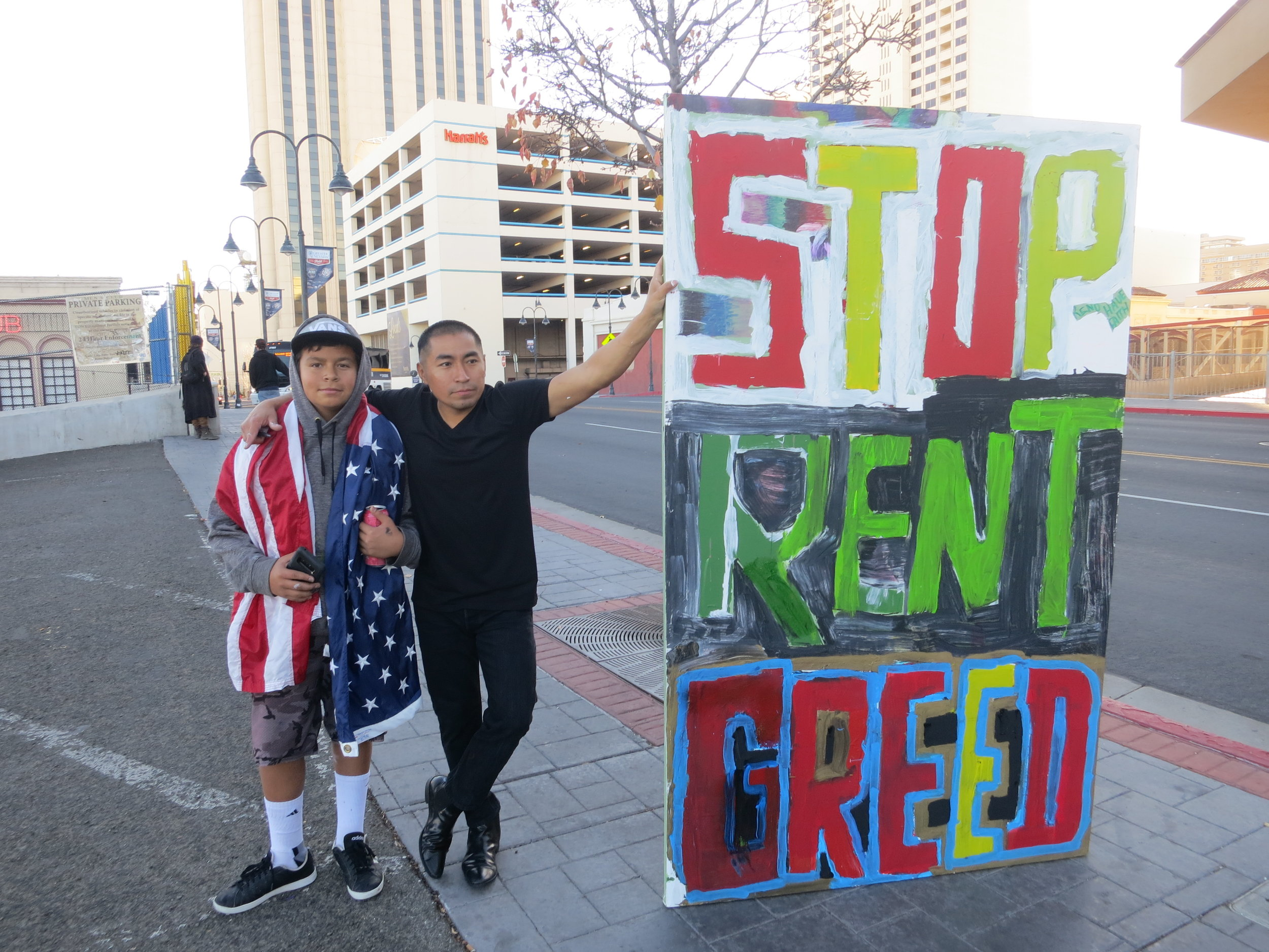 """If you think about it too much, you will never do it,"" Jhonattan said of his idea to protest the affordable housing crisis with motel kids. On Sunday, Carlos (left) and David led a group of younger kids parading a sign denouncing surging rent prices in Reno."