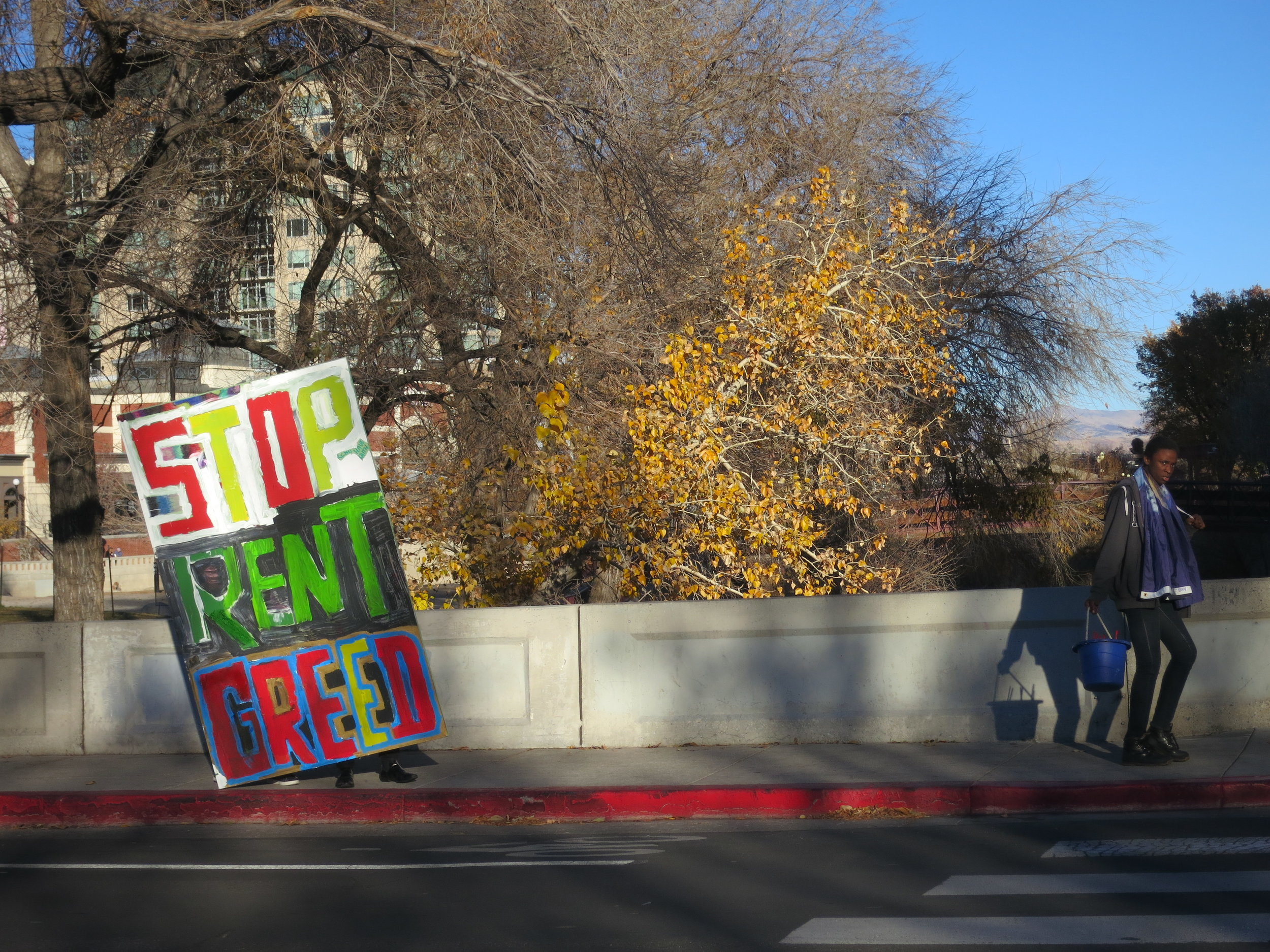 The sign made its way across downtown Reno as kids alternated holding it.
