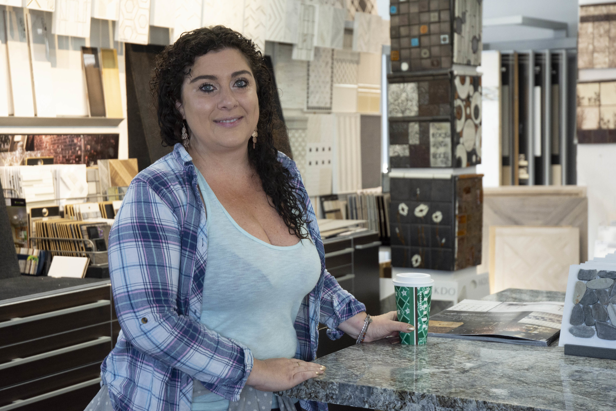 """We're at my business called Loka Tile Group and it's basically where I'm able to also store many of the materials that we use for Loka Cares,"" Angela Handler said. ""So …. loca is a Hispanic term for crazy. When I was working for a company out of Spain, they used to call me the crazy tile American girl. So when I opened up this business I wanted a four letter name, very modern and simple and we thought of Loka because it does mean crazy ....because I'm crazy for tile and this community obviously."""