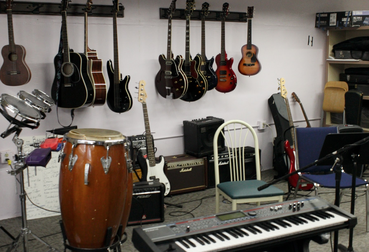 In class, the experience provided is extremely personalized to each attendee. There is a wall of guitars, multiple drum sets and microphones to get everyone involved in the day's activities.