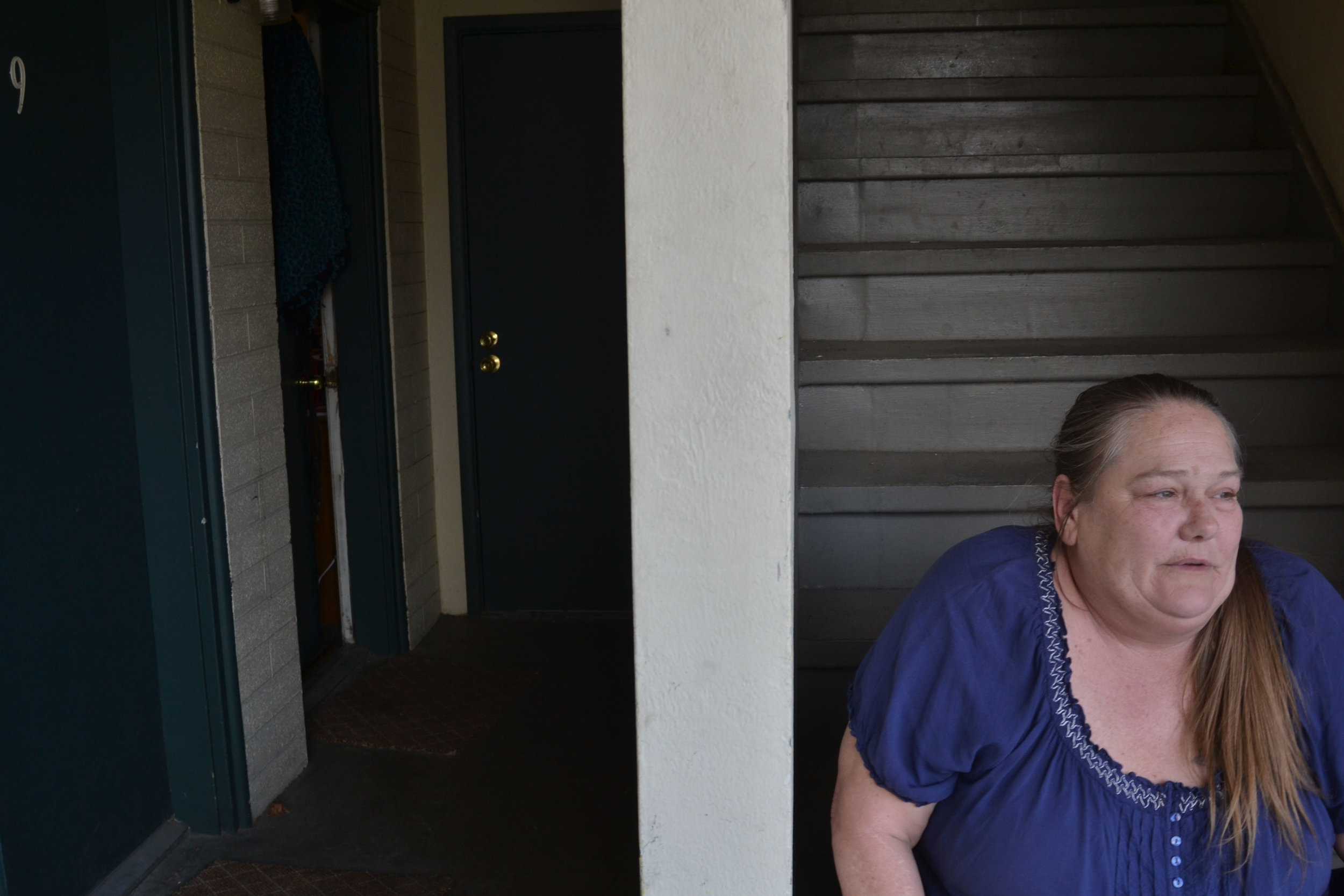 """I've had nightmares like that, you know, I don't want, I'm not going to be back on the streets again,"" Kristine Lawson, 57, said outside of her tiny room at a city motel on Virginia street. When we met her, the motel provided her a roof over her head. But considering the ongoing demolition of motels, she said she was afraid her nightmares might come true. Photo and reporting by Sudhiti Naskar"