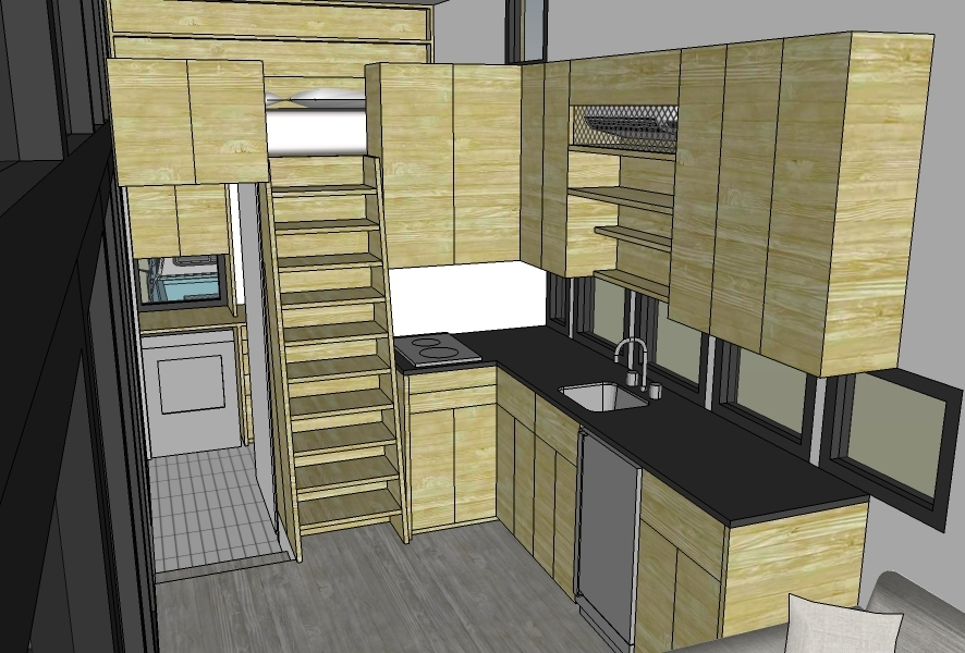 Main kitchen area with doorway to bathroom/laundry open showing sightline through window on end. AC/heat unit built into vented cabinetry above the sink.
