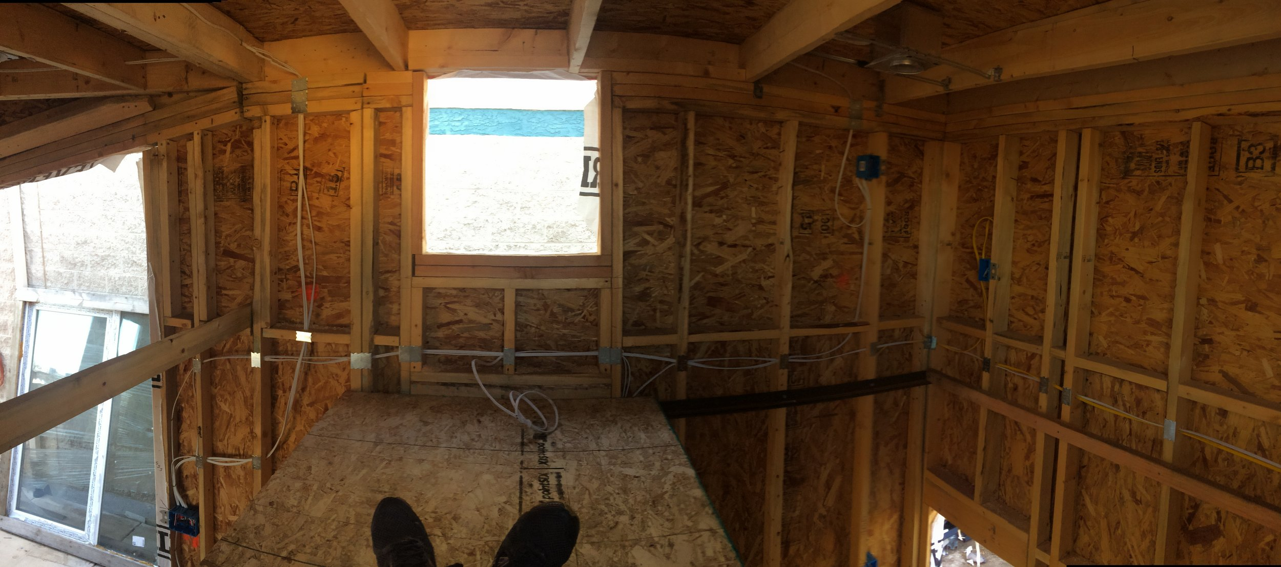 I'm sitting in the loft facing the left side. The loft will extend all the way to the rear wall. Looks like there will plenty of room for a queen bed and some small storage without being cramped. Outlets flank either side of the bed for easy electronic charging.
