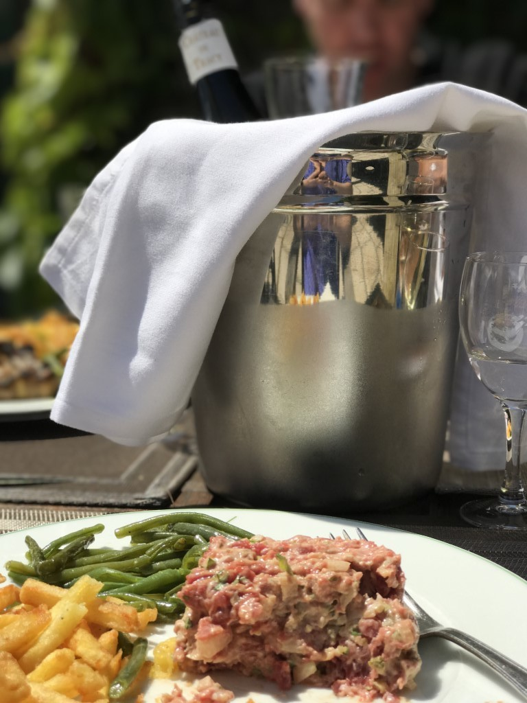 Steak tartate, frites and vin blanc on the terrace at Morfontaine