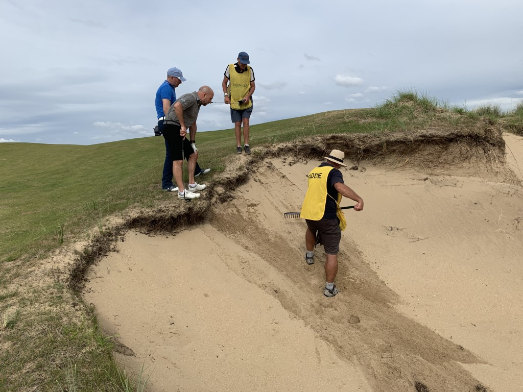 Searching for a ball in a bunker at Barnbougle Dunes