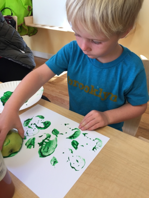 We used our fine motor skills to make apple prints! Stamp away!