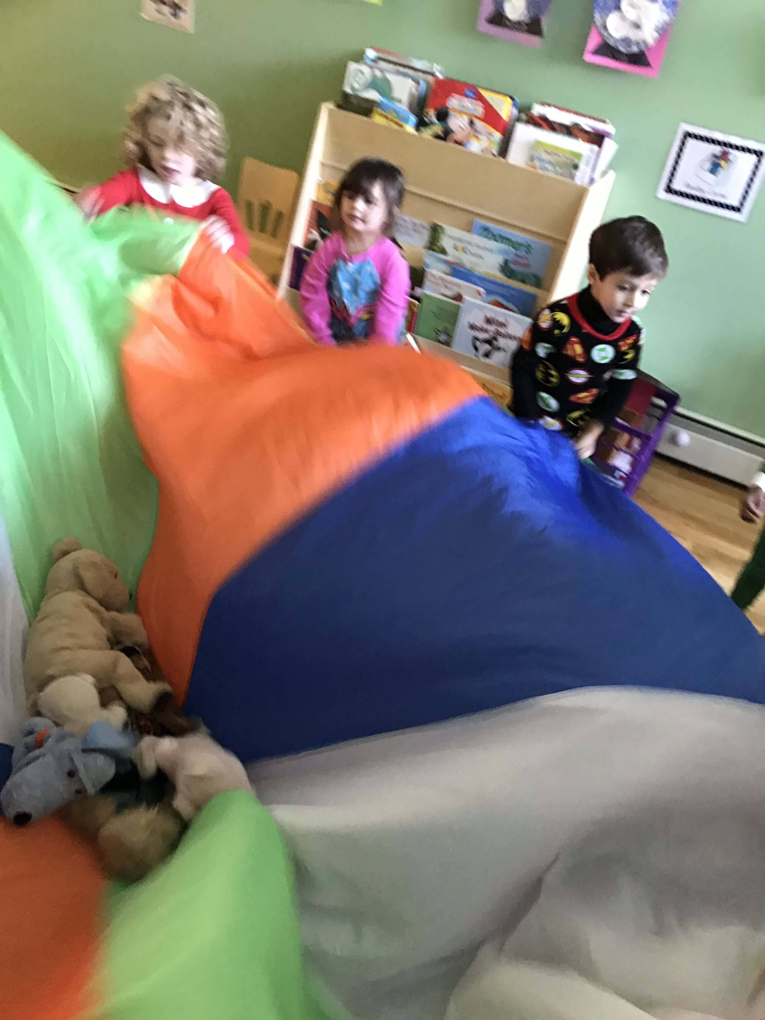 Waking up our snuggle buddies with a parachute toss!