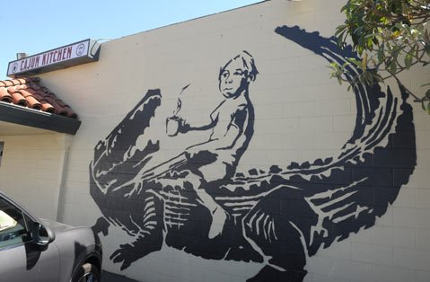 Gator Boy Mural on the Cajun Kitchen Building on Chapala