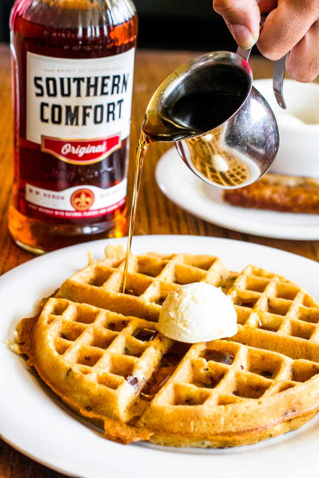 Bacon Waffle w/Bourbon Maple Syrup - $13.50 - A crispy waffle filled with bacon bits, served with a side of special Bourbon Maple Syrup. Upgrade to a combo (1 egg & choice of sausage links, ham, and bacon strips) for $2.00.