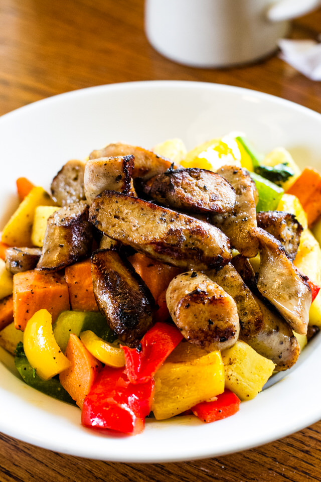 Apple-Chicken Sausage Mishmash - Apple-Chicken Sausage, sweet-potatoes, yams, red bell peppers, yellow bell pepper, green bell pepper, & Kale. Served with a choice of breakfast bread-side (toast, cornbread, biscuits, or blueberry muffins).