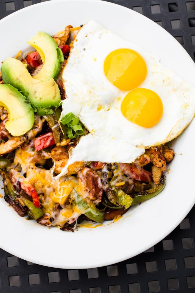 Cajun Bowl – $13.95 - Blackened Chicken & shrimp with hot sausage, homefries, peppers, onions, avocado, topped with shredded cheddar and jack cheese topped with 2 eggs. The dish will be served with a choice of bread