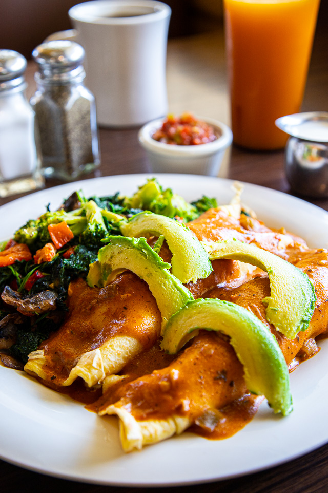 Blackened Seafood Étouffée Crepes – $13.99 - 2 savory crepes filled with sautéed spinach and a choice of Blackened: Shrimp or Crawfish. Topped with our étouffée sauce and avocado. Served with a side of mixed veggies.(May substitute the veggies for breakfast potatoes)