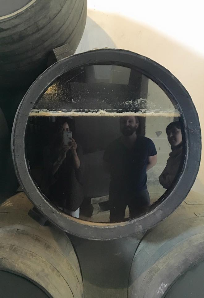 Reflections from A special glass-sided Sherry barrel. This way, visitors can see the protective yeast, known as flor, on top of the wine.