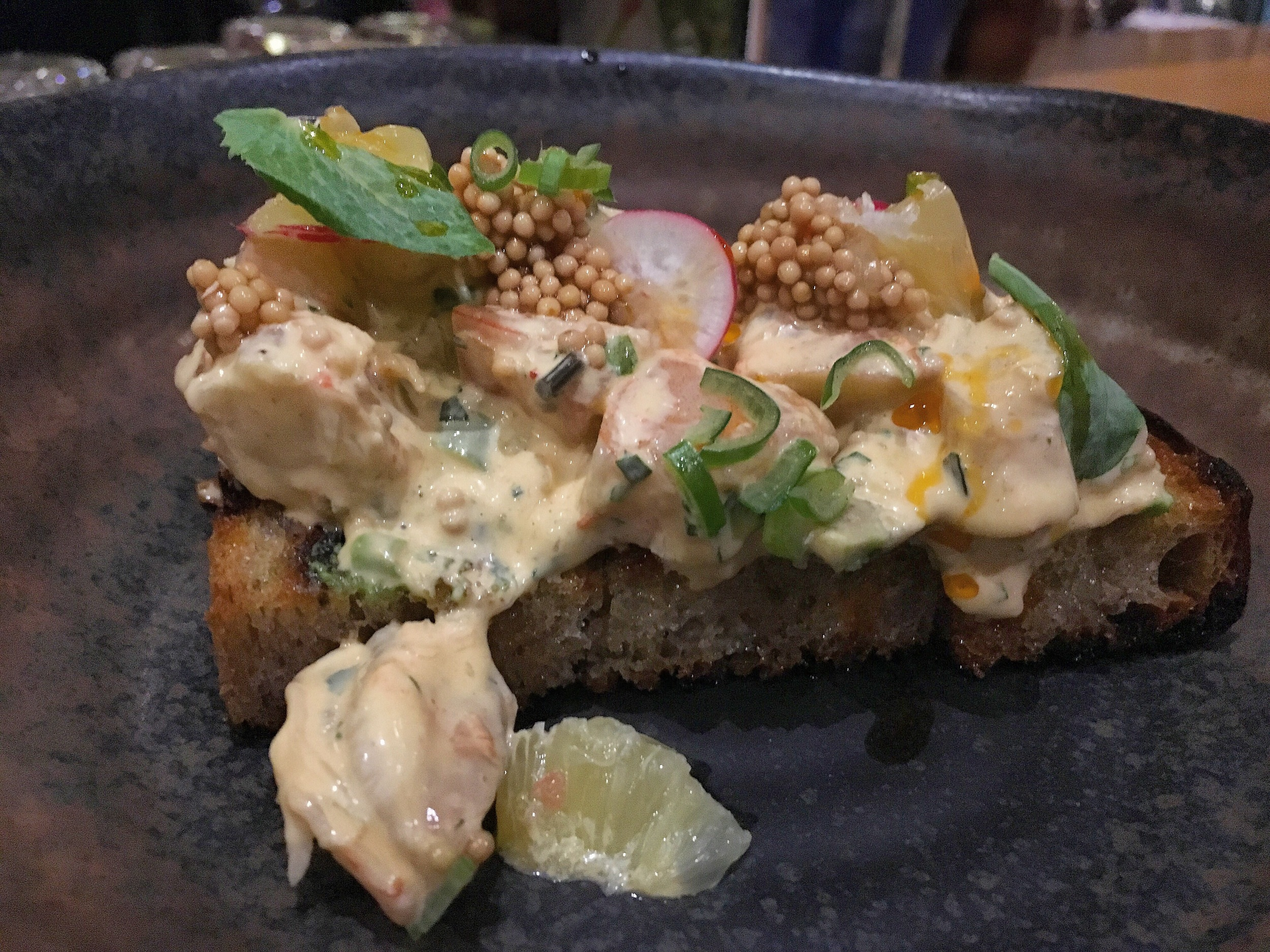 shrimp, avocado, radish grapefruit and mustard seed on light and fluffy rye toast