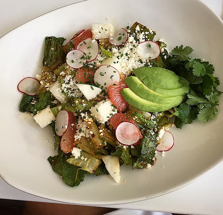 romaine chopped salad with avocado, grapefruit, jicama, almond and queso fresco with a chili vinaigrette
