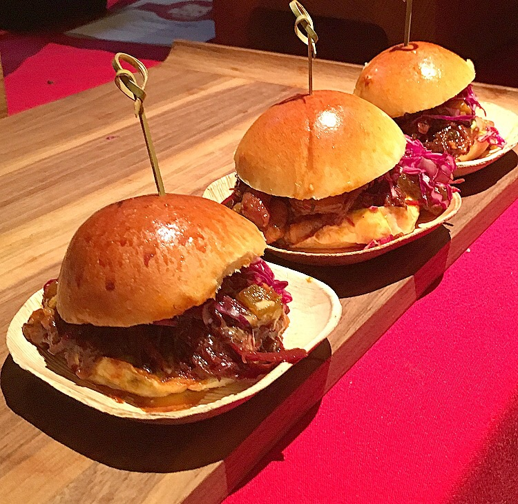 Rainbow Room Bar 's short rib sliders with red bean stew, chili aioli, avocado and pickled red cabbage