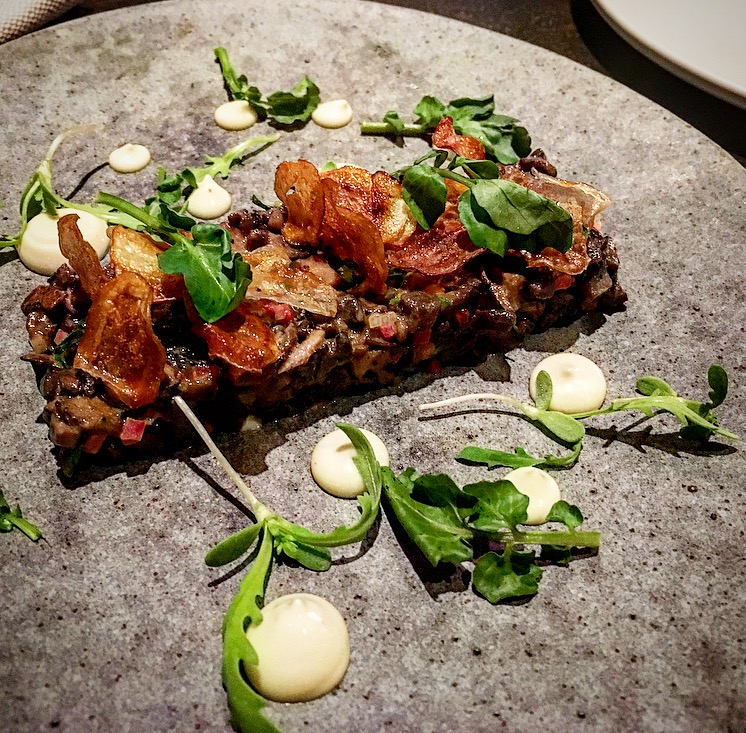 Mushrooms with fingerling potato, roasted garlic and watercress. Delicious!!