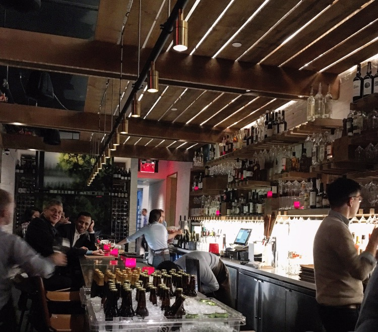 The lovely bar at Rouge Tomate is a wonderful, comfortable spot to spend the evening.
