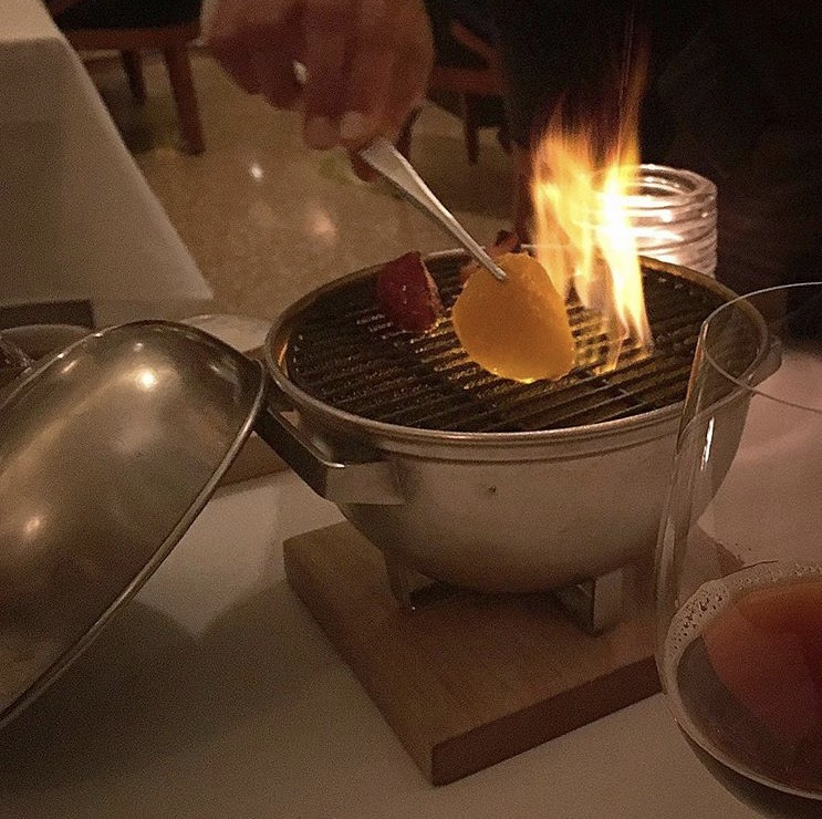 Grilling the apricots table side for dessert, Eleven Madison