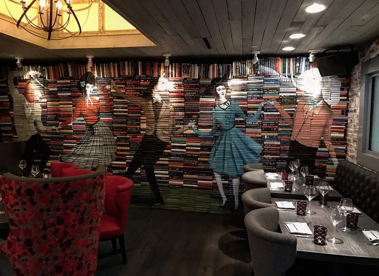 One of the dining rooms at The Tuck Room.  Those are real books that were painted on!