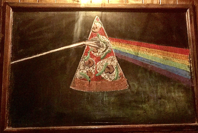 A little pizza artwork on the walls