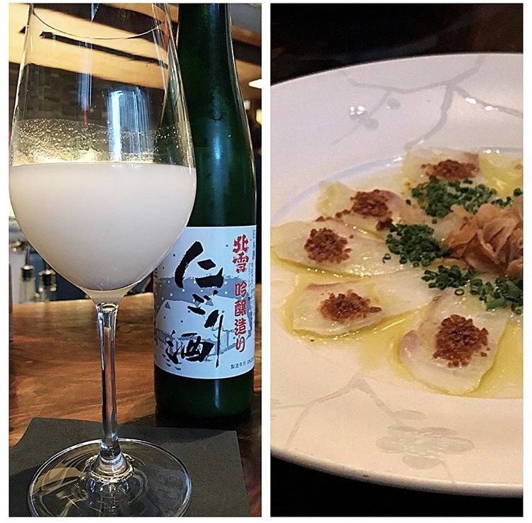 Unfiltered sake with fluke crudo at Nobu 57.