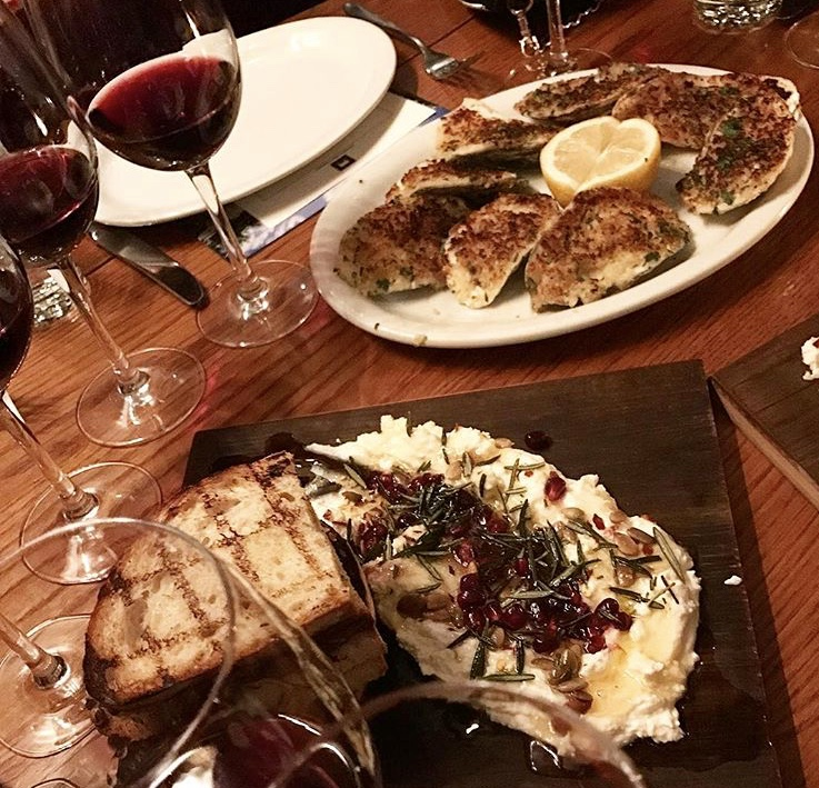 Ricotta toasts and oysters with cheesy breadcrumbs at Bowery Meat Company.