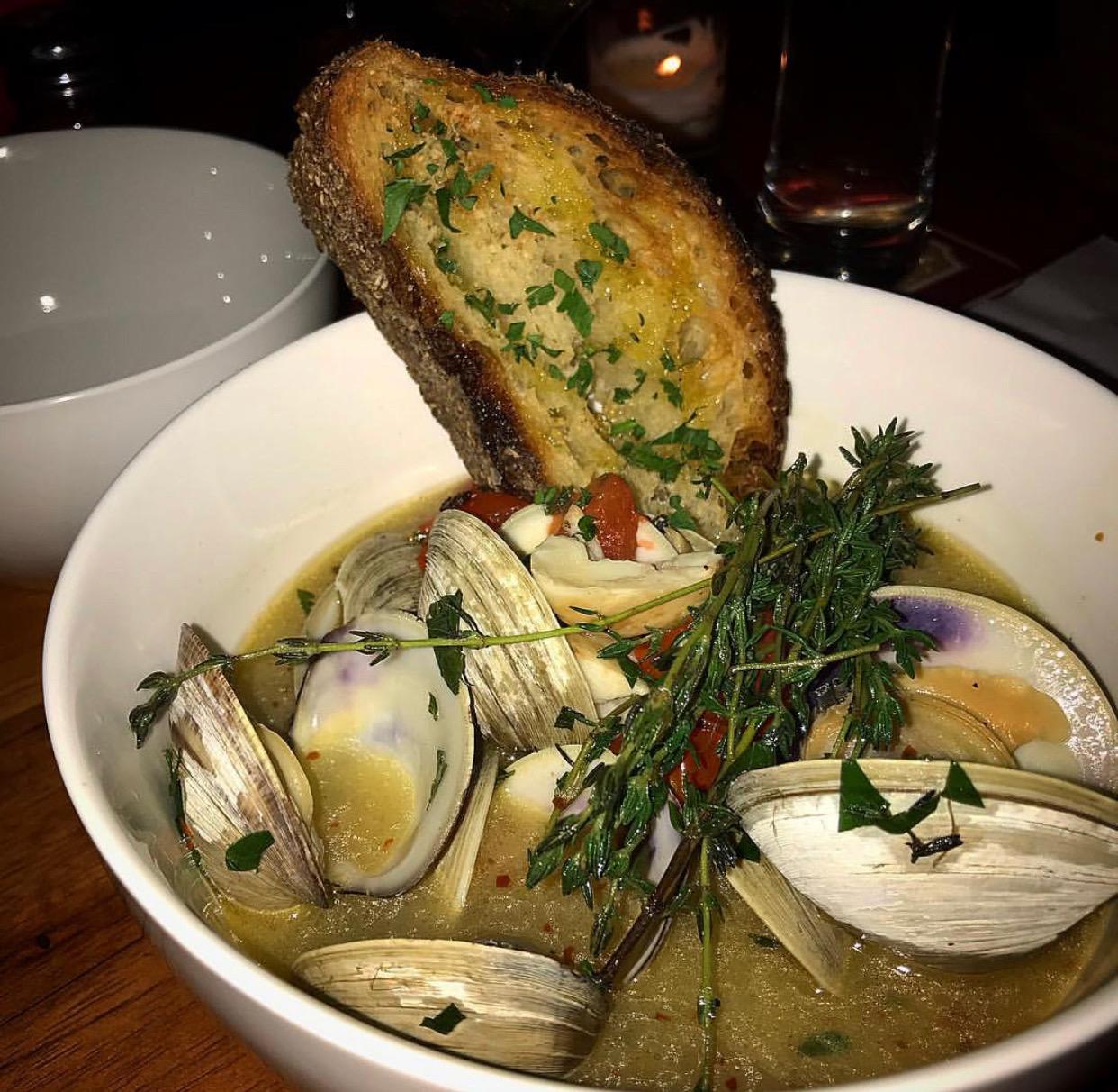 Bin 71's clams in broth with garlic toast.
