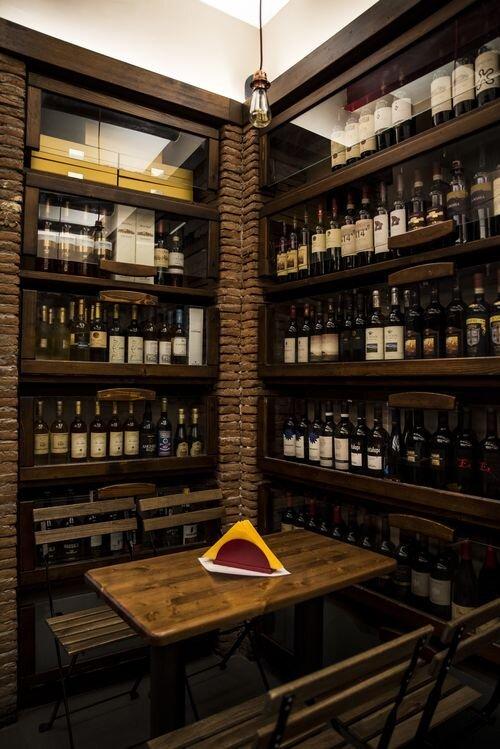 wine bottles line the walls at Enoteca Belledonne.